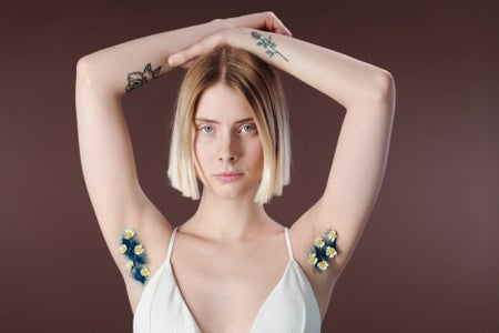 woman with flower body hair