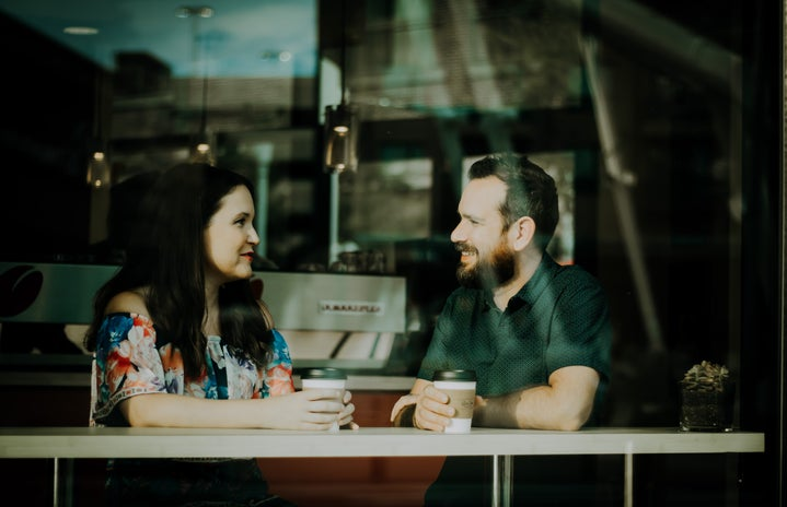 Couple talking with coffee