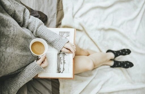 girl with coffee and book