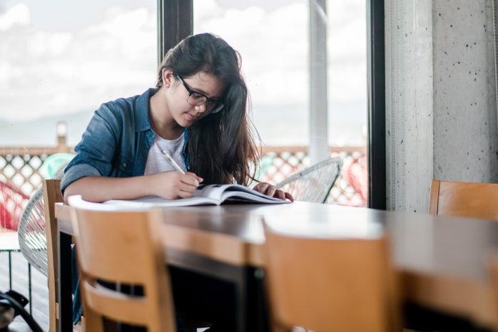 Woman writing in book