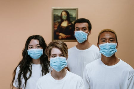 young adults wearing masks with mona lisa.