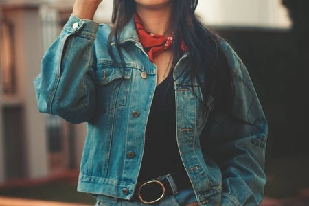 woman wearing denim jacket and jeans