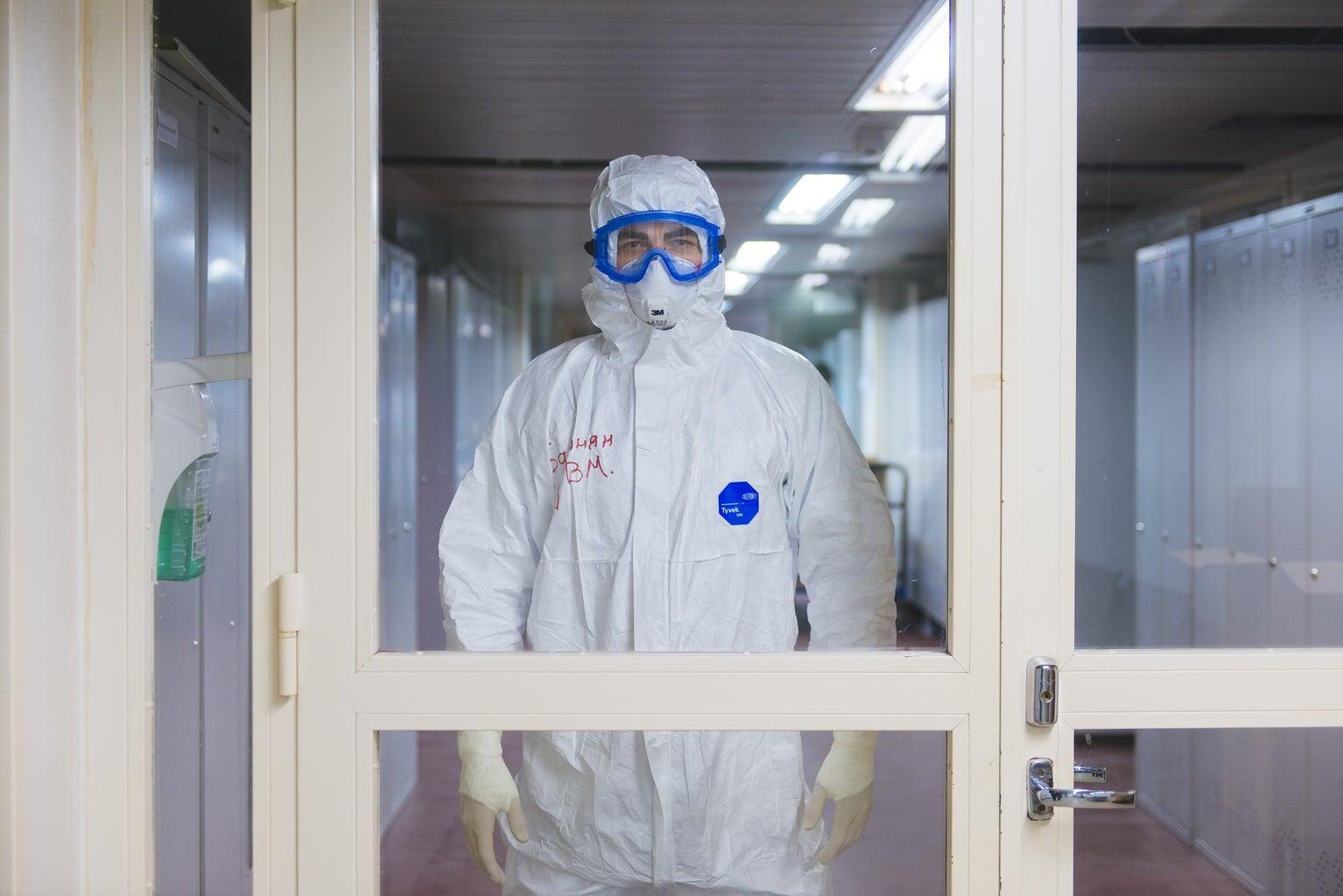 COVID medical personnel standing in door