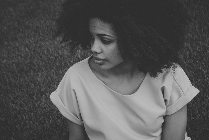 girl in black and white with curly hair