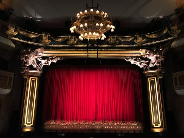 Red curtains closed on a stage