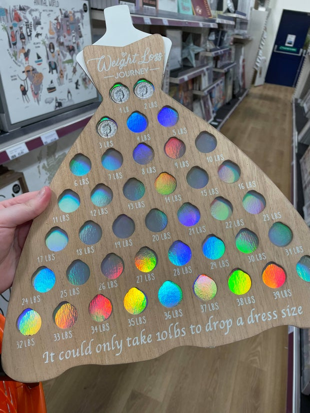 Wooden weight loss tracker in the shape of a dress