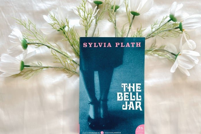 A picture of a book \'The Bell Jar\' with flowers