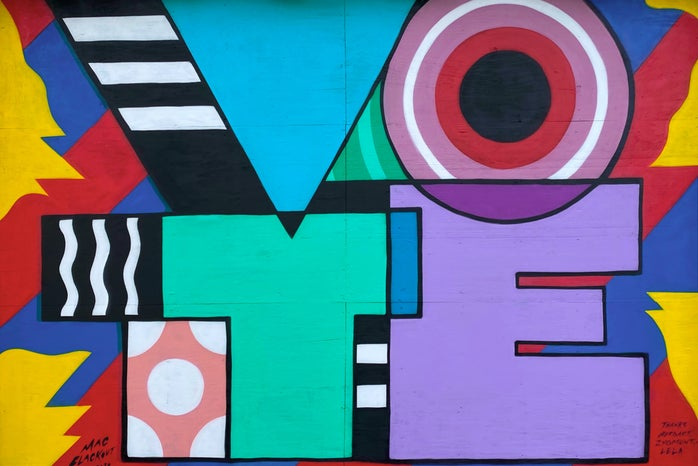 """colorful mural that says \""""vote\"""""""