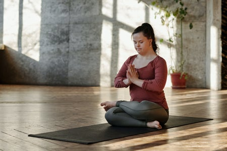 woman meditating alone