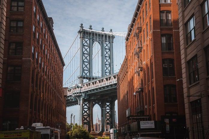 Manhattan bridge seen between buildings