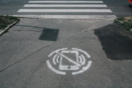 "A spray paint of a ""no phone"" icon"