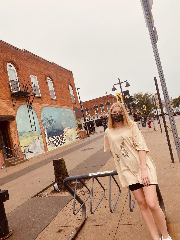 Girl leaned against bike rack in Iowa City