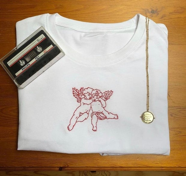 Image of embroidered top by Elaine, who owns small irish business. It is a T-shirt. And Elaine took the photo