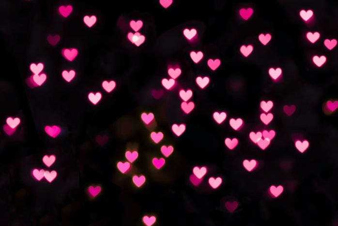 Pink hearts on black background