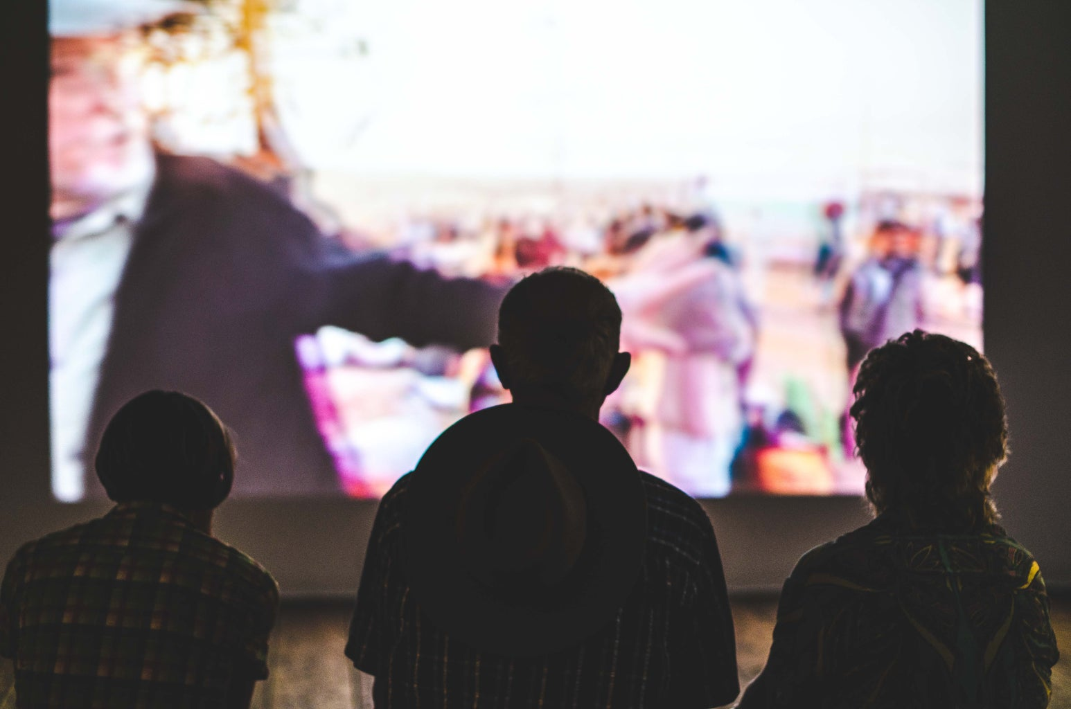 People in front of a screen