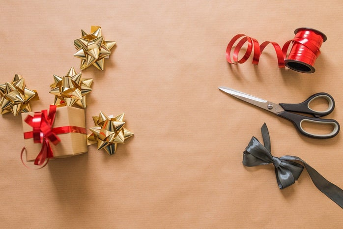 arts and crafts bows, scissors, and a wrapped present