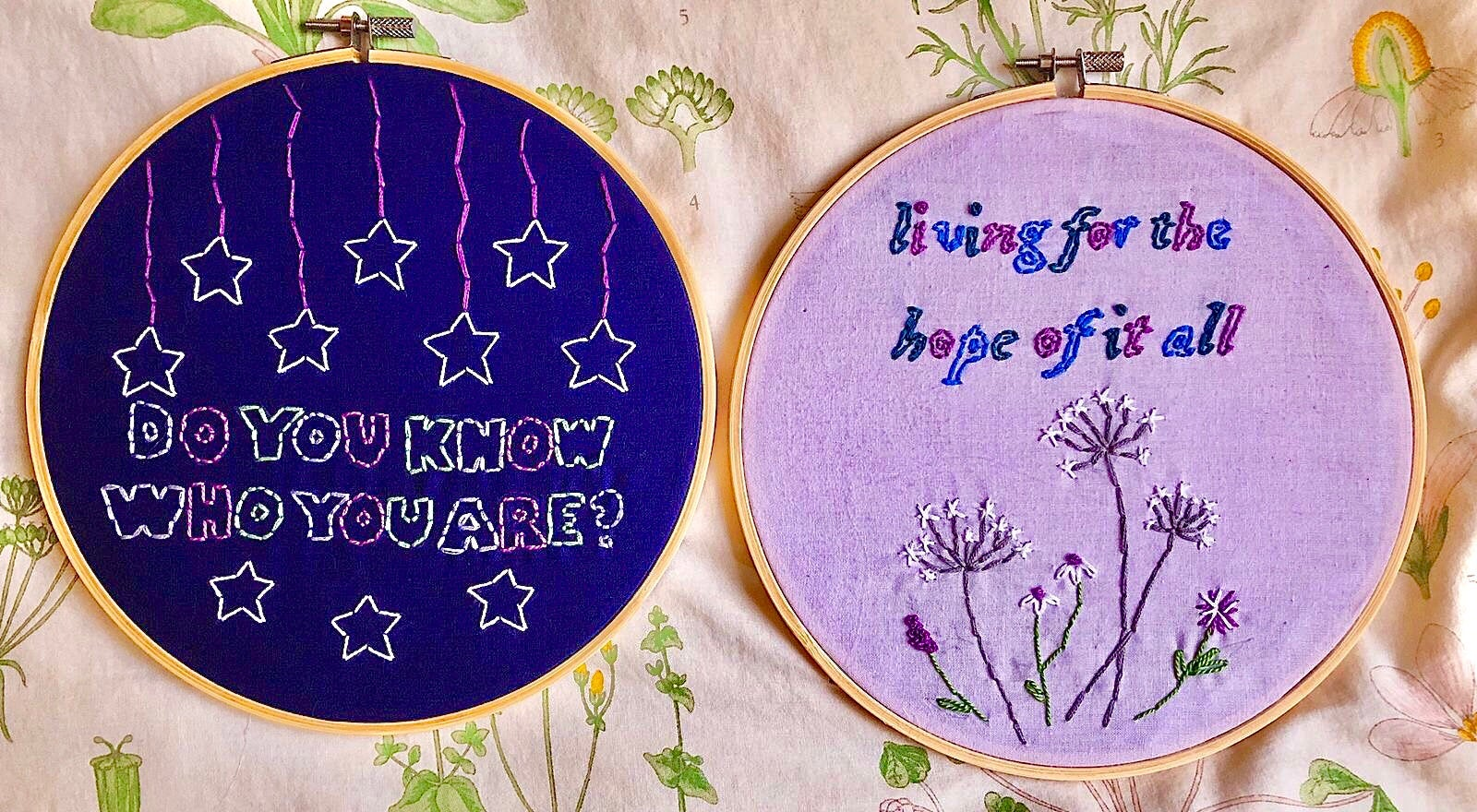 Photo of two embroidery wheels, one with lyrics from Taylor Swift and one with lyrics from Harry Styles.