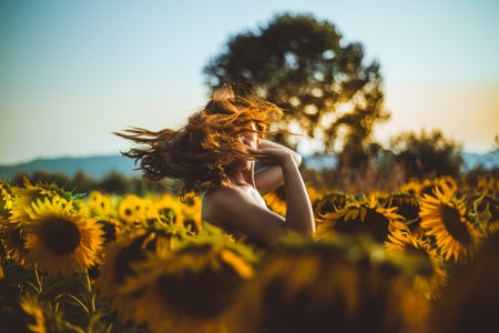 woman standing in a sunflower field