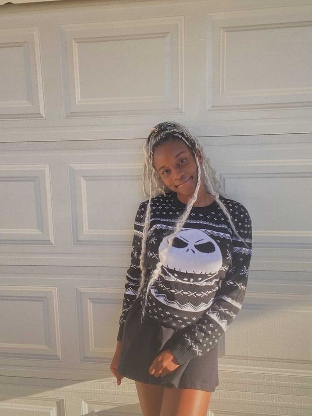 young woman wearing nightmare before christmas sweater