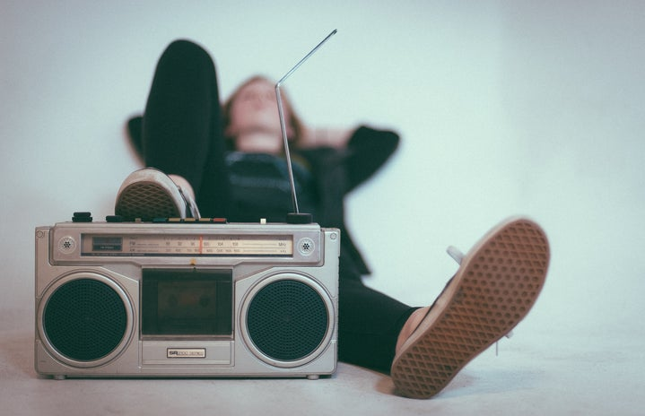 woman laying down with her foot on a radio