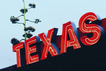 """neon sign that reads """"TEXAS"""""""