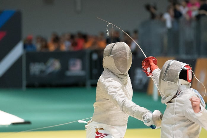 two fencers in a dual