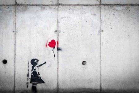 graffiti of child with balloon