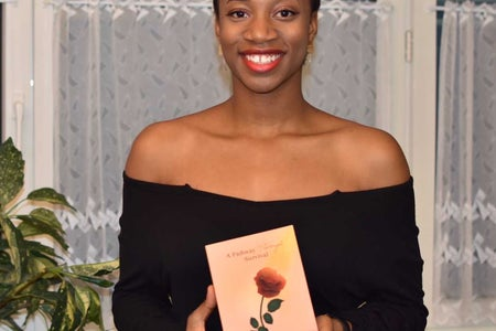 Black girl holding book