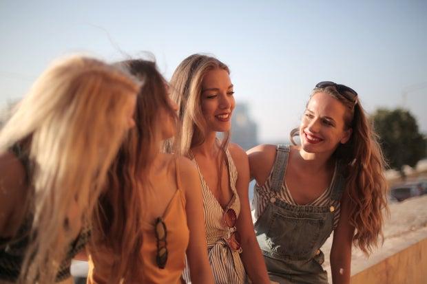 women outside smiling