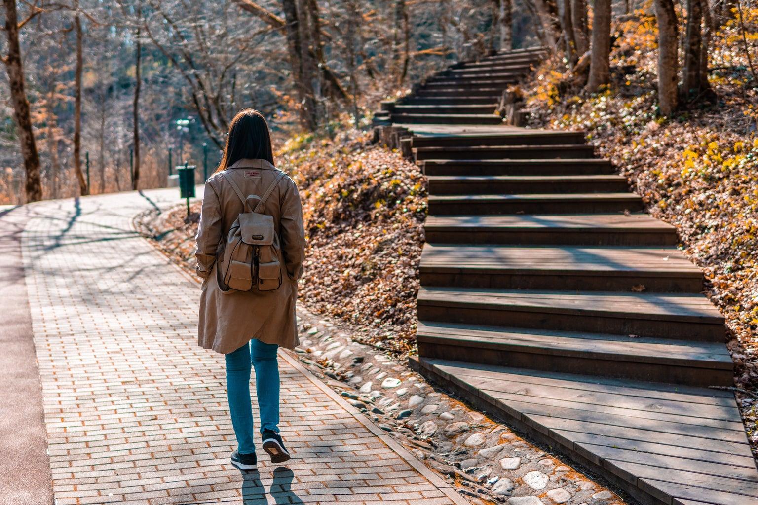 woman Walking On Brick Road