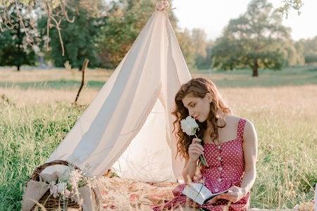 Girl reading at a picnic