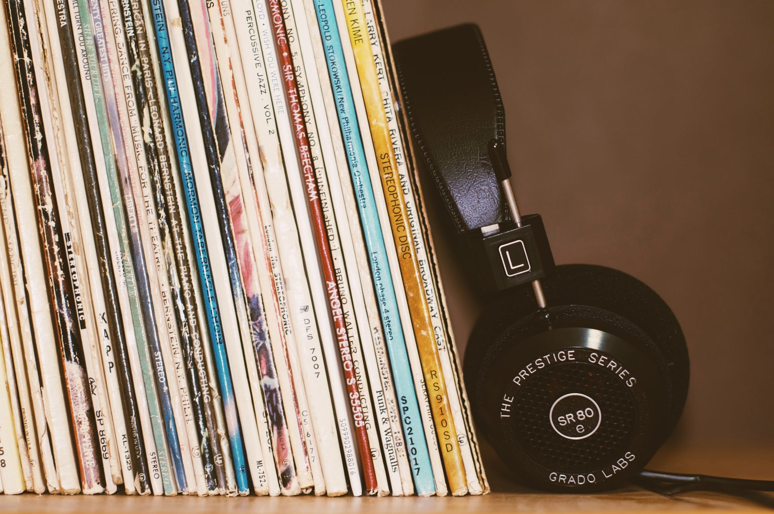 headphones leaning against record albums