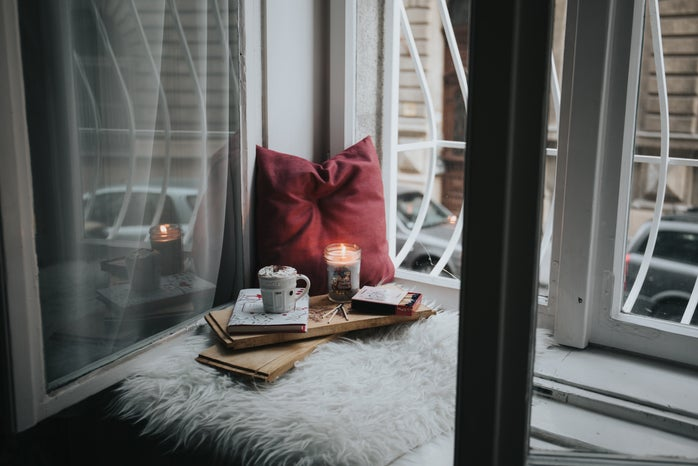 Cozy setup with coffee and candle