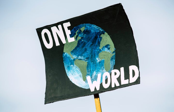 """Sign that reads \""""One World\"""" at climate change protest in Germany"""