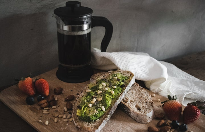 Avocado toast, fruits and nuts, and coffee.