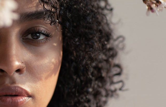 black woman with about half of her face showing