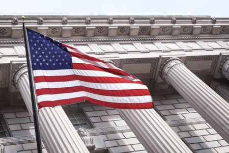 American flag in front of columns