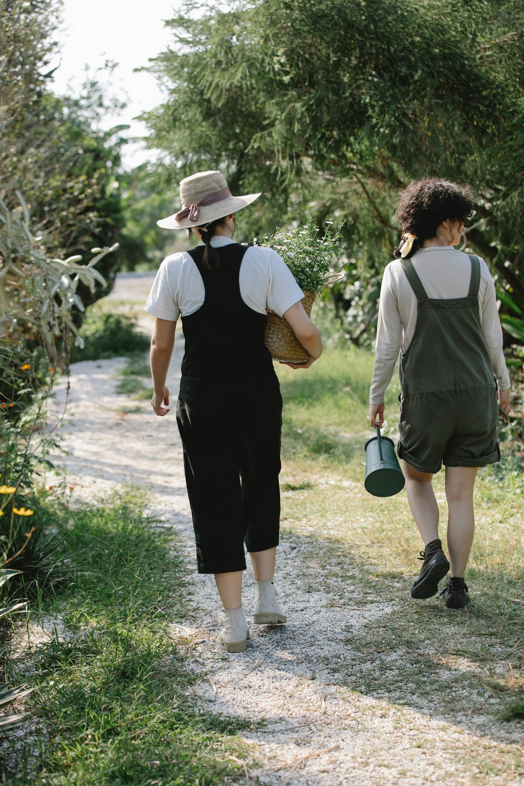 Two people walking in a rural ambience