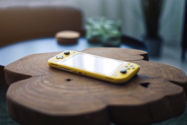 yellow and silver video game controller