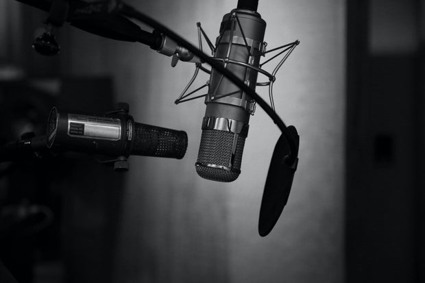 grayscale photo of a podcast setup