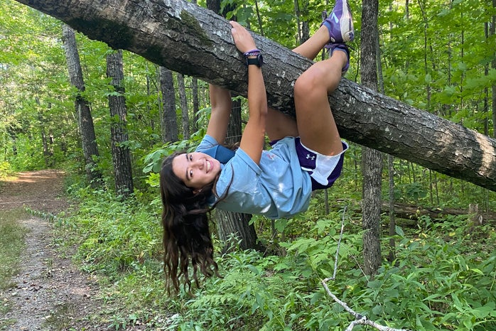 Woman swinging on a tree branch