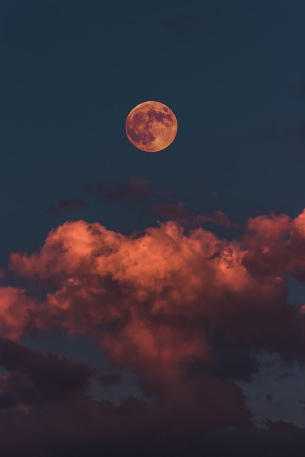 orange full moon and clouds