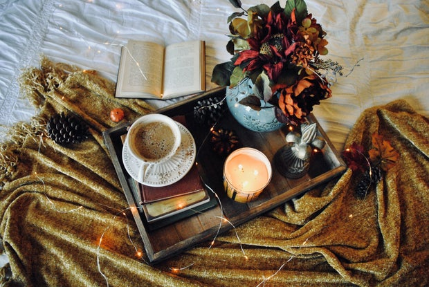 white teacup in fall bedroom