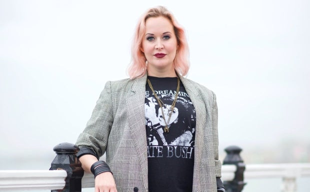 woman in blazer and graphic t-shirt