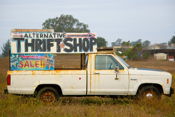 white single cab truck with signage