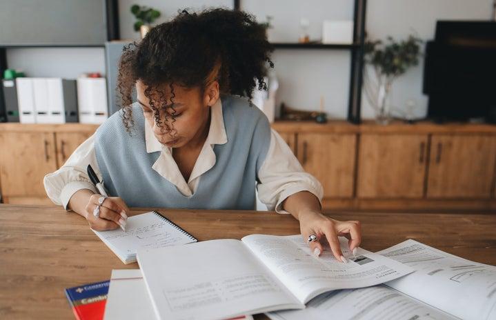 woman student doing homework