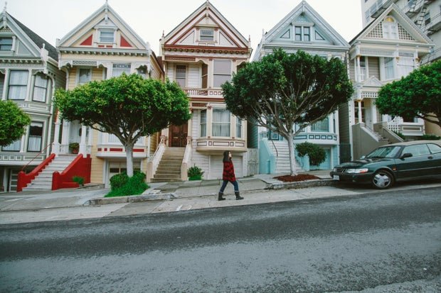 San Francisco houses, lady walking in front of them