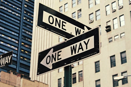 "two street signs that say ""one way"" but point in opposite directions"