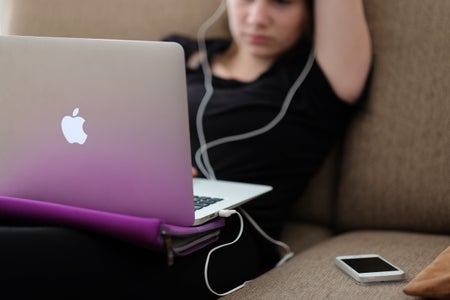 Person listening to music on laptop