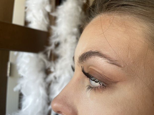girl with mascara on from side